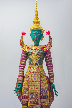 Thai puppet doll with traditional headpiece and costume.