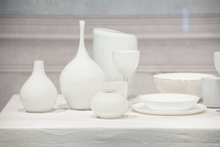 White porcelain food wares on a white table.