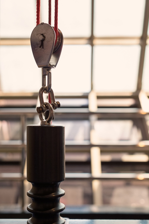 Pulley with red rope cable carry the weight of opened glass roof Stock Photo