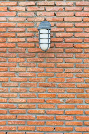 Outdoor lighting lamps with bricks wall background. Stock Photo