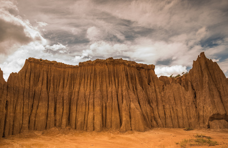 Clay sculpture caused by rainwater eroded the surface. Collapse or collapse The stronger soil will stay on top without collapsing. Stock Photo