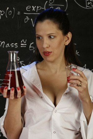 Young woman working on an experiment in her laboratory    photo
