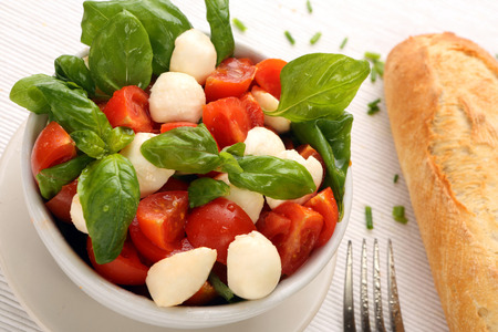 Caprese salad  Tomato and mozzarella with basil  photo