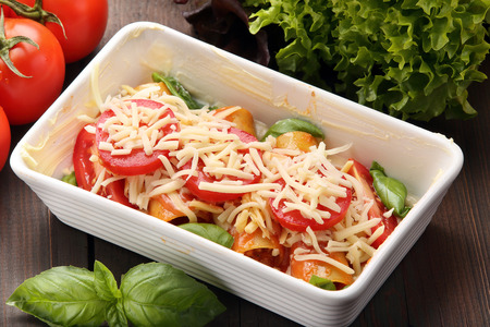 roasting pan: Cannelloni prepare to bake in a roasting pan on a wooden background Stock Photo