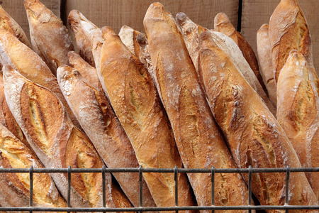 French baguettes in metal basket in bakery photo