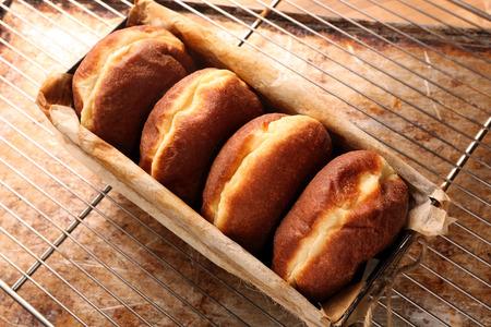 rack arrangement: Fresh donuts in bakery mold