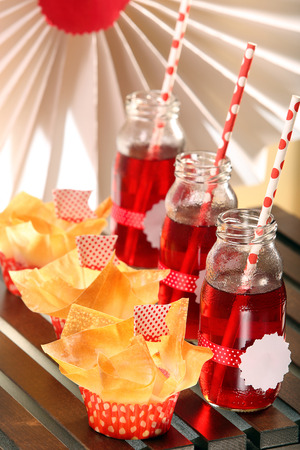 filo: Muffins with filo pastry and cranberry juice in bottles for a party