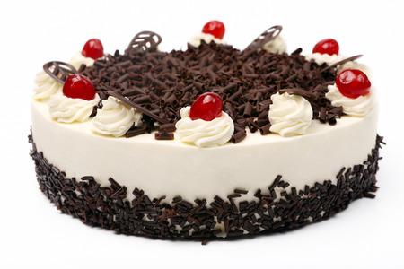 Cream vanilla cake with chocolate and cherries on white background photo