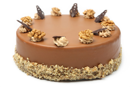 Walnut cake with icing on white background