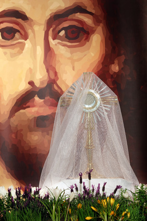 Monstrance with the body of Christ in the church during Easter photo