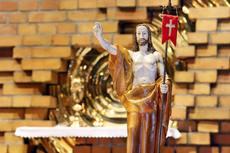 easter triduum: Wooden figure of Jesus resurrected, in the church during Easter