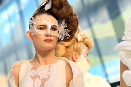 hairstyling: POZNAN - APRIL 18: Model concept hairstyling extreme show at The Look Beauty Vision Poznan 2015 on April 18, 2015 in Poznan, Poland.