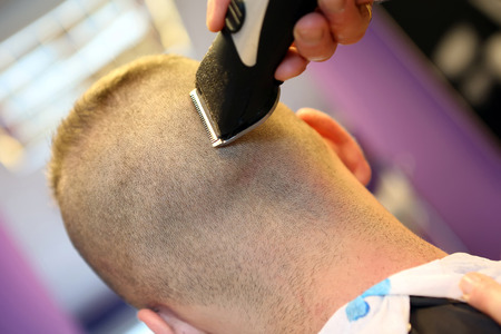 haircutter: Barber cutting and modeling hair by electric trimmer