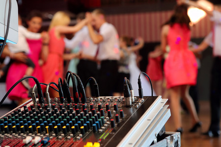 dj party: Dancing couples during the party or wedding celebration