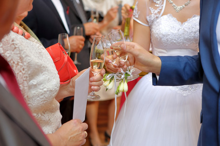 Young couple at a wedding reception with champagne glasses