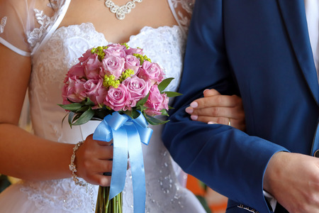 newlyweds: Newlyweds with wedding rose bouquet