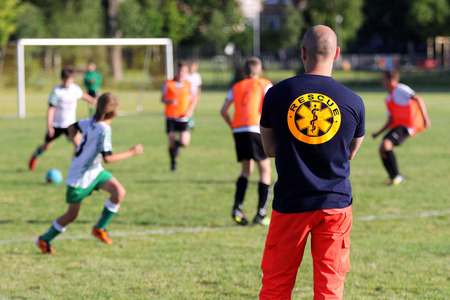 rescuer: Medical rescuer for a football game of young boys