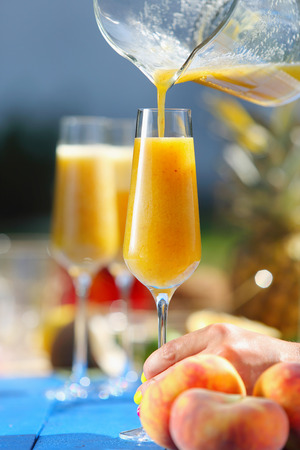 Italian Bellini alcoholic cocktail with peach Stock Photo - 43646389