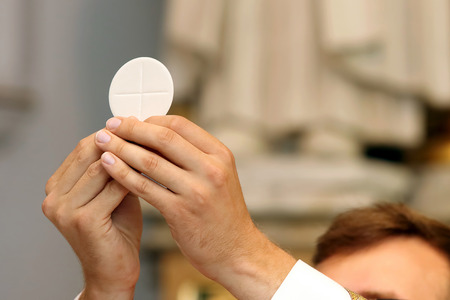 holy eucharist: Priest celebrate a mass at the church Stock Photo