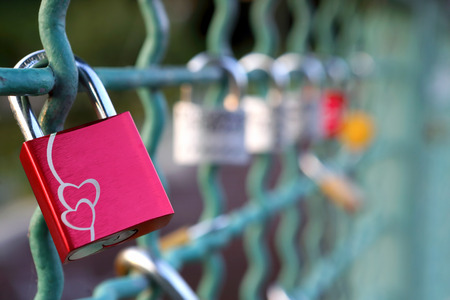 wedding symbol: Love padlocks on a railing of bridge on blurred background with space for text
