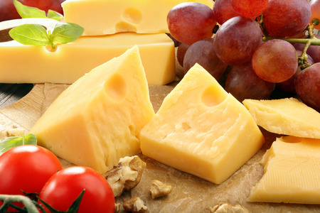 different types of cheese: Yellow cheese composition on the cheese board