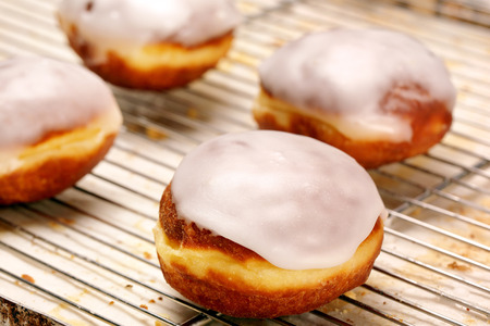 icing: Fresh donut with icing in bakery