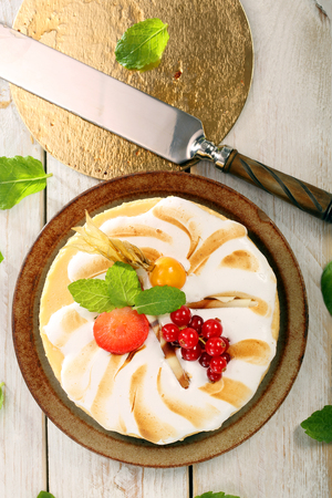 phisalis: Pudding cake with fruit on a wooden background