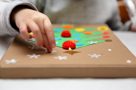 Child making decoration for Christmas Stock Photo