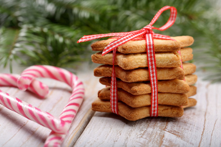 holiday cookies: Christmas cookies with decoration on wooden background