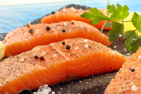 Fresh raw salmon fillet and aromatic spices for baking