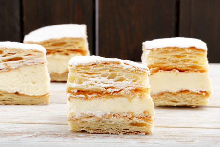 puff pastry: Puff pastry cake with cream and powdered sugar. Catering set.