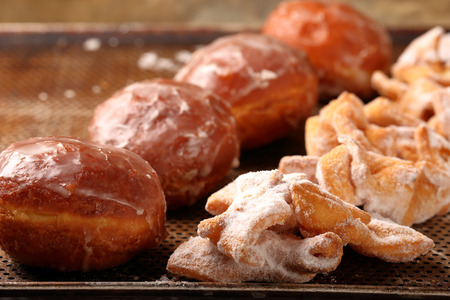 Donuts and faworki. Traditional Polish cookies on Fat Thursday Archivio Fotografico