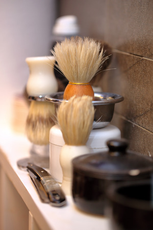 barber background: Brush and razor shaving in barber shop Stock Photo