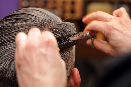comb hair: Barber cutting and modeling hair by scissors and comb