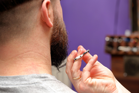 barber scissors: Barber cutting and modeling beard by scissors Stock Photo