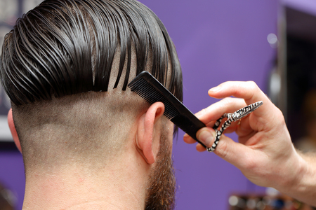 barber scissors: Barber cutting and modeling hair by scissors and comb