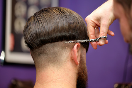 barber scissors: Barber cutting and modeling hair by scissors