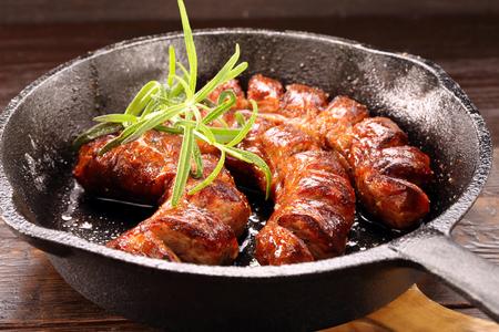white sausage: White sausage frying in a pan