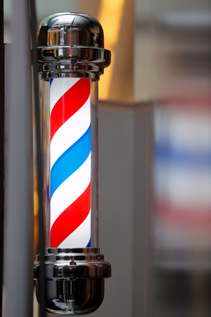barber: Barber shop vintage pole Stock Photo