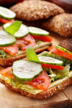 vegetarian hamburger: Vegetarian sandwich with pesto on wooden background Stock Photo