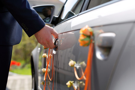 gets: Groom gets into the car