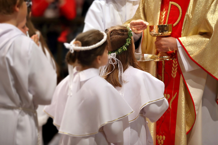 religious clothing: Children going to the first holy communion