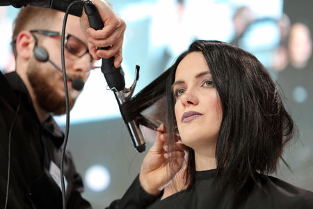 hairclip: POZNAN, POLAND - MAY 07. 2016: Hairdresser arranging hairdo at The Look Beauty Vision Poznan 2016 on May 07 in Poznan, Poland. Editorial