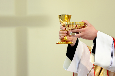 Priest celebrate a mass and holy communion at the church