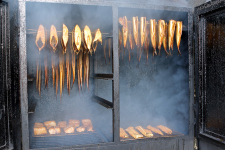Golden smoked fish in a smoker