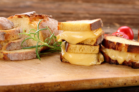 Sandwiches with corn bread with melted cheese Stock Photo