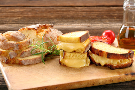 Sandwiches with corn bread with melted cheese and space for text Standard-Bild