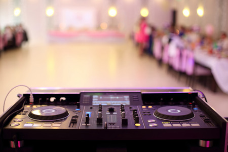 Empty hall during party or wedding celebration by dj mixer and space for text