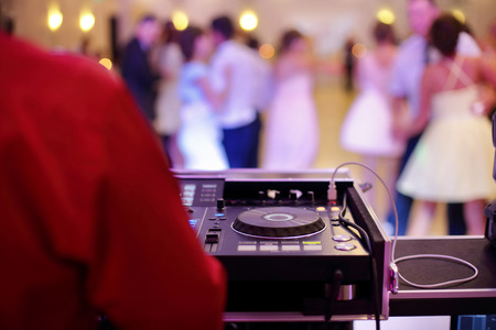 Dancing couples during party or wedding celebration by dj mixer and space for text Stockfoto