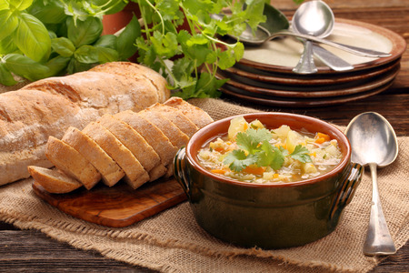 Autumn vegetable soup with toasts and space for text